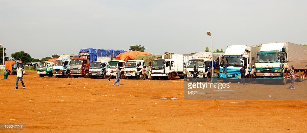 Trucks entering Southern Sudan from Uganda line up at the border customs of Nimule (Copyright - Getty Images)